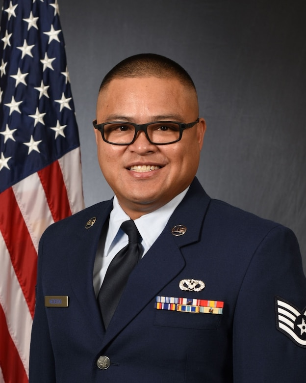 Staff Sgt. Jeff Nededog, 254th RED HORSE Squadron construction and pavement journeyman, poses for his official photo on Andersen Air Force Base, Guam, Sept. 12, 2019.