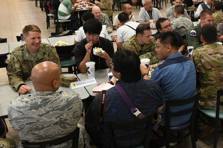 Airmen from the 18th Wing talk and have lunch with Twitter Tour participants at Kadena Air Base, Japan, Nov. 4, 2019. The participants were selected based on when they subscribed to the 18th Wing Twitter page and a brief application process. (U.S. Air Force photo by Staff Sgt. Peter Reft)