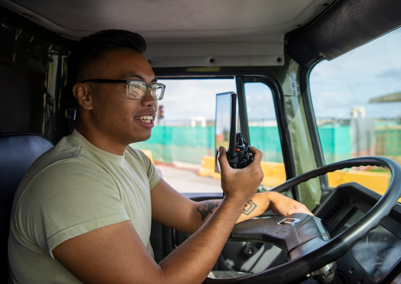 Airman 1st Class Zachary Alcantara, 36th Logistic Readiness Squadron distro operator, radios for help during a fuel spill exercise on Andersen Air Force Base, Guam, Nov. 6, 2019.