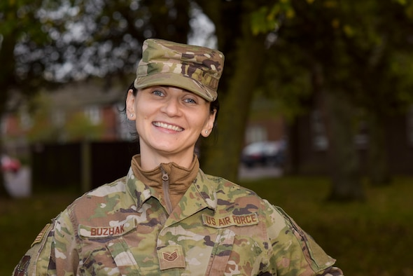 U.S. Air Force Staff Sgt. Olga Buzhak, 352nd Special Operations Wing financial analyst, poses for a picture at RAF Mildenhall, England, Oct.27,2019. Buzhak traveled from her birth place of Minsk, Belarus - not to leave a war-ridden country or to escape poverty- but simply to see a different, better life and a new experience in America. (U.S. Air Force photo by Senior Airman Alexandria Lee)