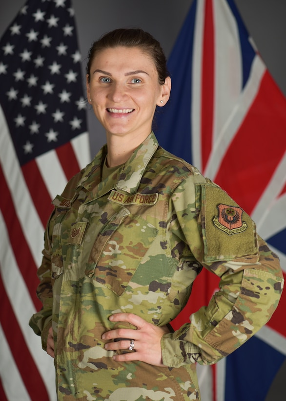 U.S. Air Force Staff Sgt. Olga Buzhak, 352nd Special Operations Wing financial analyst, poses for a picture at RAF Mildenhall, England, Oct.27,2019. Buzhak traveled from her birth place of Minsk, Belarus to New York City at 19 with a few hundred dollars – to create a new life and joining the U.S. Air Force. (U.S. Air Force photo by Senior Airman Alexandria Lee)
