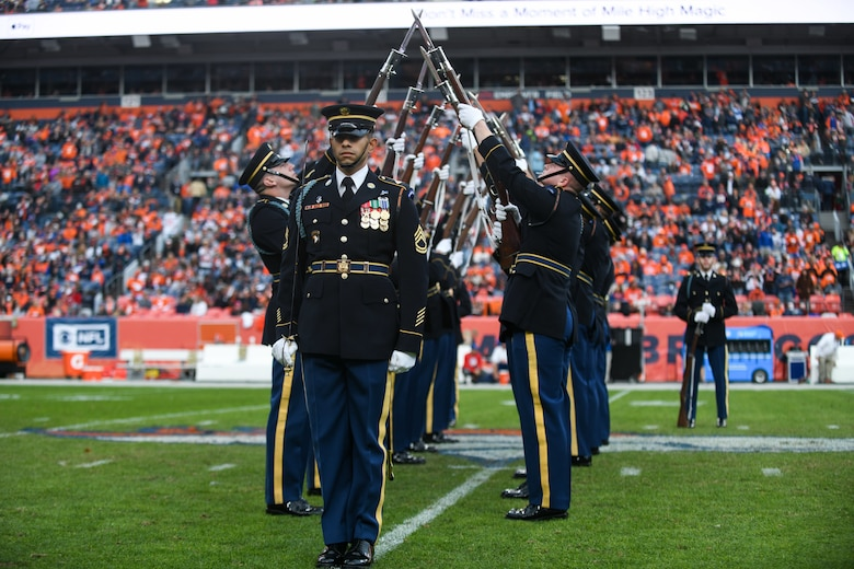 The U.S. Army Drill Team from Washington D.C.,performs during the halftime show for the Denver Broncos Salute to Service game, Nov. 3, 2019, at Empower Field in Mile High in Denver.