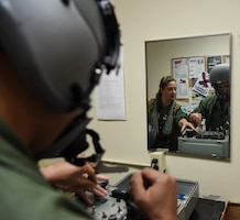Capt. Rachel Long (left), 69th Expeditionary Bomb Squadron radar navigation officer, and Capt. Jon Guile, 69th EBS B-52 Stratofortress aircraft commander, check their helmets on an Oxygen Mask Test Unit on Andersen Air Force, Guam, Oct. 22, 2019. The 69th EBS aircrew members support the Indo-Pacific region by fulfilling the Continuous Bomber Presence mission housed on Andersen. The CBP provides rapid global strike capabilities, assurance to our allies in deterrence to possible adversaries, and maintains security and stability in the Indo-Pacific region. (U.S. Air Force photo by Airman 1st Class Michael S. Murphy)