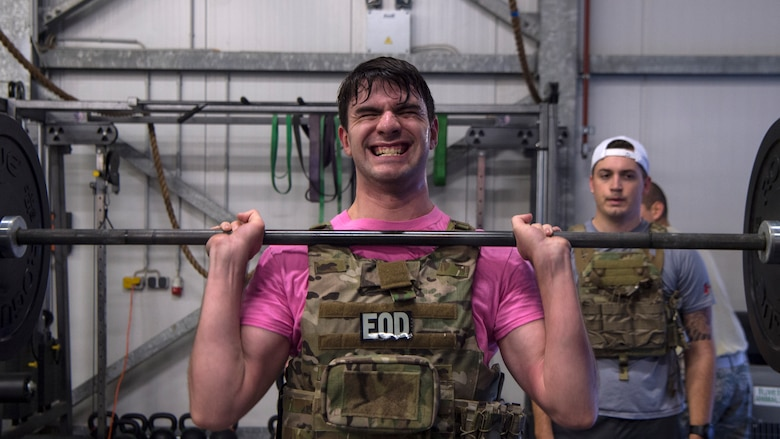 U.S. Air Force Senior Airman Kenaniah Taft, explosive ordnance disposal technician, performs a hang power clean at Ramstein Air Base, Germany, Nov. 5, 2019.