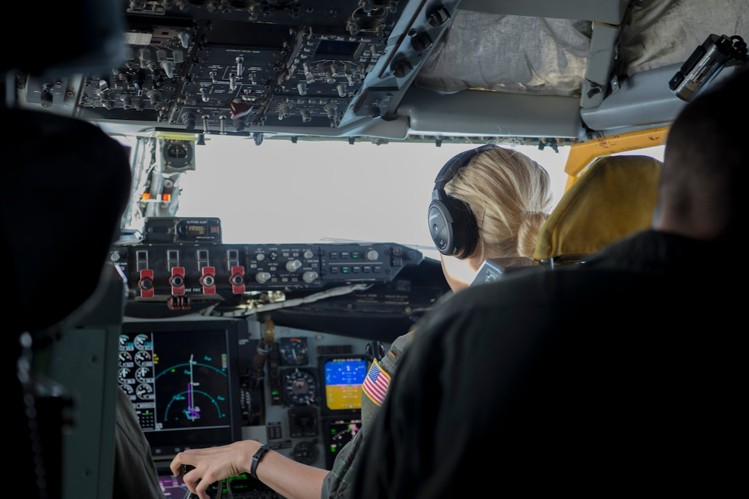 U.S. Air Force 2nd Lt. Michelle Christensen, a 63rd Air Refueling Squadron pilot, operates the controls of a KC-135 Stratotanker during a refueling mission Nov. 4, 2019.  Christensen successfully completed her first flight, while providing air refueling support to the national global strike and strategic deterrence mission.