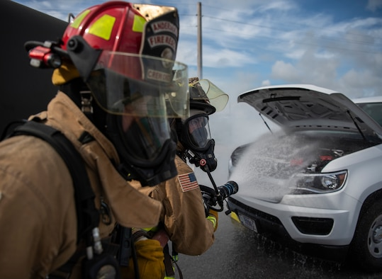 Staff Sgt. Jacob Hester (left), and Senior Airman Luis Leon, 36th Civil Engineer Squadron firefighters, respond to a simulated fire during a fuel spill exercise on Andersen Air Force Base, Guam, Nov. 6, 2019.