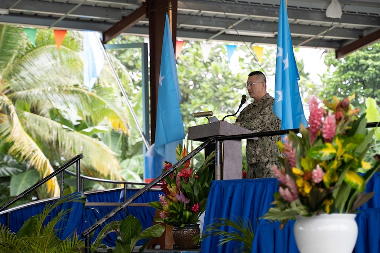 191104-N-WA745-1020 KOLONIA, Pohnpei (Nov. 4, 2019) Lt. Young Han, the chaplain deployed with Naval Mobile Construction Battalion (NCMB) 5, gives the invocation for the Federated States of Micronesia Independence Day celebration at the Kolonia Gymnasium in Pohnpei Nov. 4. The Seabees deployed with NMCB-5's Detail Pohnpei are providing humanitarian aid to the local community by finishing a medical facility, Nan U Dispensary, and performing renovations to multiple schools across the island. NMCB-5 is deployed across the Indo-Pacific region conducting high-quality construction to support U.S. and partner nations to strengthen partnerships, deter aggression, and enable expeditionary logistics and naval power projection.