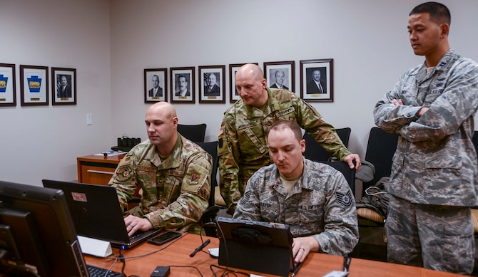 Approximately 30 members of the Pennsylvania National Guard joined other state agencies at three locations Nov. 5 to ensure the security of the commonwealth's general election. A team at the Pennsylvania Emergency Management Agency (above) focused on network monitoring, while teams at Fort Indiantown Gap and Horsham Air Guard Station focused on social media reporting. (U.S. Army National Guard photo by Staff Sgt. Zane Craig)