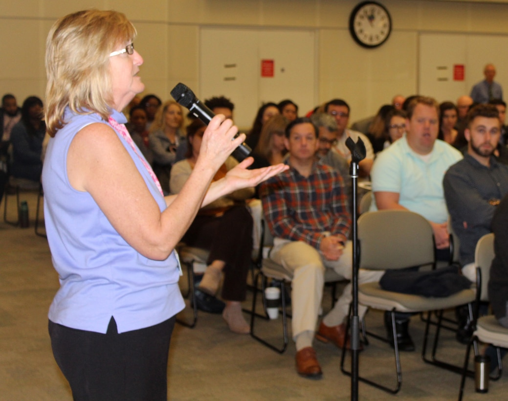 Joyce Pezick, foreground, a DLA Troop Support Industrial Hardware employee, clarifies a technical and engineering question posed by acquisition employees at an IH cross-functional event Nov. 5, 2019 in Philadelphia.