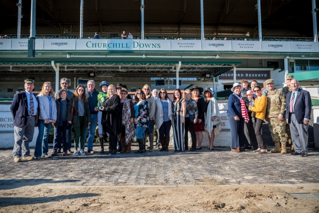 Gold Star family members are joined by Air Force Gen. Joseph Lengyel, chief of the National Guard Bureau, in the winner's circle to present the trophy for a race named in honor of Gold Star Families at the tenth annual Survivors Day at the Races at Churchill Downs in Louisville, Ky., Nov. 3, 2019. The event welcomed nearly 1,000 family members of fallen service members for a day of fellowship and healing. (U.S. Air National Guard photo by Staff Sgt. Joshua Horton)