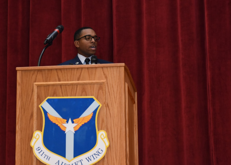 Senior Airman Joseph Dukes, knowledge operations management specialist with the 911th Communications Squadron, sings the National Anthem at an assumption of command ceremony in honor of 911th Airlift Wing commander Col. John F. Robinson at Moon Area Middle School in Coraopolis, Pennsylvania, Nov. 2, 2019.