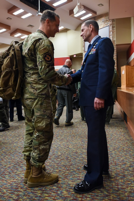 Col. John F. Robinson, 911th Airlift Wing commander, shakes the hand of an Airman of the 445th Operations Group from Wright-Patterson Air Force Base, Ohio, after his assumption of command ceremony in Coraopolis, Pennsylvania, Nov. 2, 2019.