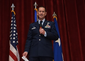 Col. John F. Robinson, 911th Airlift Wing commander, addresses Airmen and guests during his assumption of command ceremony at Moon Area Middle School in Coraopolis, Pennsylvania, Nov. 2, 2019.