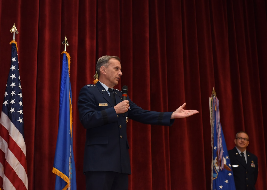 Maj. Gen. Randall A. Ogden, 4th Air Force commander, introduces Col. John F. Robinson as the new commander of the 911th Airlift Wing during a ceremony at Moon Area Middle School in Coraopolis, Pennsylvania, Nov. 2, 2019.