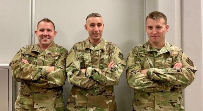 Staff Sgt. David Potter, Tech. Sgt. Andrew Potter, and Staff Sgt. Samuel Potter pose together before departing for deployment.