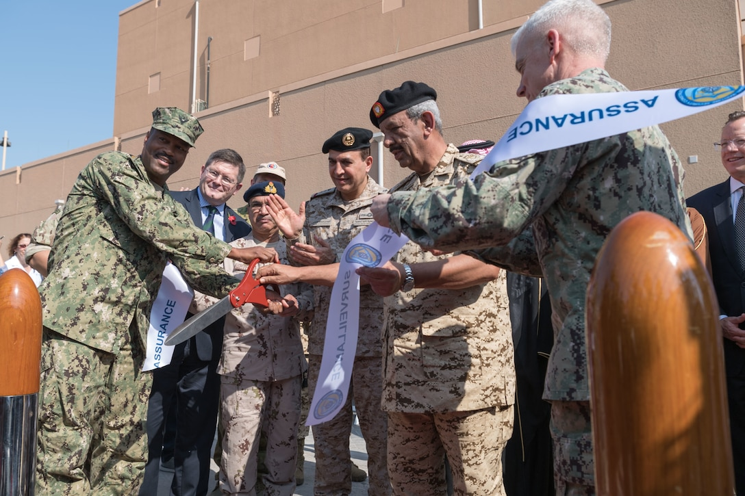 191107-N-KZ419-1001 NAVAL SUPPORT ACTIVITY BAHRAIN, Bahrain (Nov. 7, 2019)  Vice Adm. Jim Malloy, commander of U.S. Naval Forces Central Command, U.S. 5th Fleet and Combined Maritime Forces, right, Rear Adm. Alvin Holsey, commander of Coalition Task Force (CTF) Sentinel and other senior partner military leaders cut a ceremonial ribbon during the CTF Sentinel ribbon-cutting ceremony. CTF Sentinel is a multinational maritime effort to promote maritime stability, ensure safe passage, and enhance freedom of navigation throughout key waterways in the Arabian Gulf, Strait of Hormuz, the Bab el-Mandeb Strait and the Gulf of Oman. (U.S. Navy photo by Mass Communication Specialist 3rd Class Dawson Roth/Released)