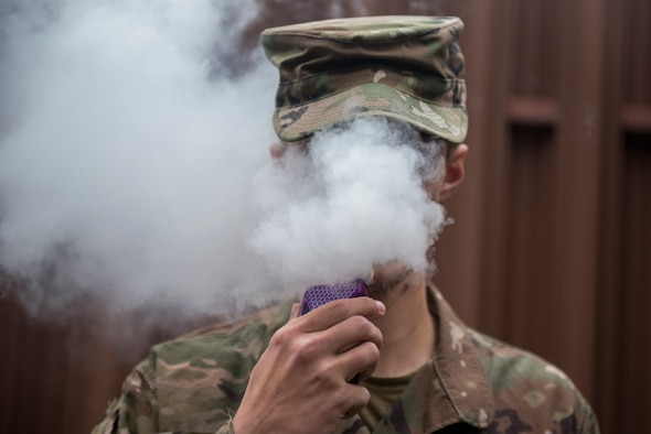 A Team Offutt airman vapes in an authorized smoking area during a break Nov. 7. As of Oct. 29, 2019, over 1,800 lung injury cases and 37 deaths have been reported to the Centers for Disease Control and Prevention and the only commonality among all cases is the patient's use of e-cigarette or vaping products.