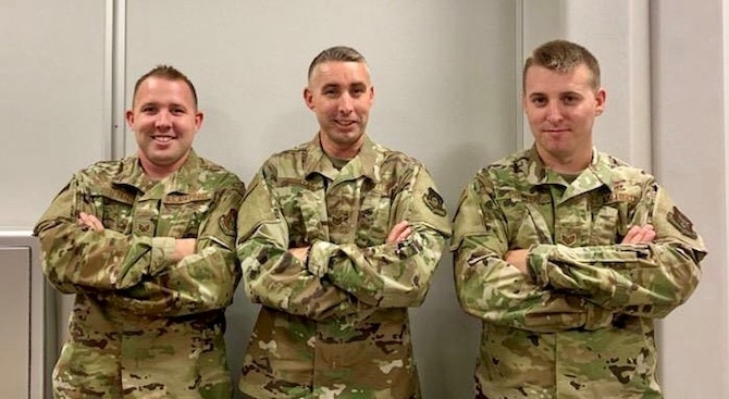 Staff Sgt. David Potter, Tech. Sgt. Andrew Potter, and Staff Sgt. Samuel Potter pose together before departing for deployment.