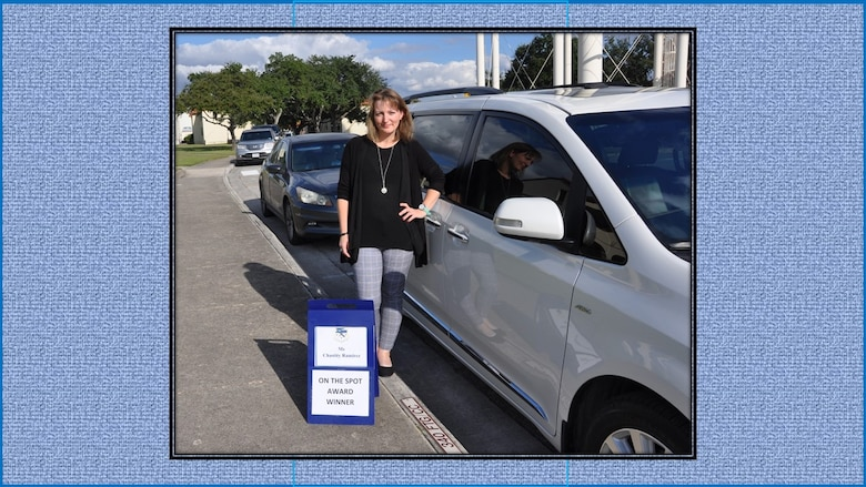 Chastity Ramirez, 340th Flying Training Financial Services travel lead, claims her time in the commander's parking spot following selection as the 340th FTG October On-the-Spot Award winner. Nicely Done Chastity! (U.S. Air Force photo by Janis El Shabazz)