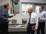 191009-N-XO599-097 NORCO, Calif. (October 9, 2019) Naval Surface Warfare Center, Corona Division (NSWC Corona) Laboratory Manager Michael Wheeler, left, gives a tour of the Measurement Science and Technology Lab to Program Manager for Ammunition Warren C. Clare, Marine Corps Systems Command, right, and Branch Head Steve Howell, center. (U.S. Navy photo by Becky Cleveland (CTR)/Released)