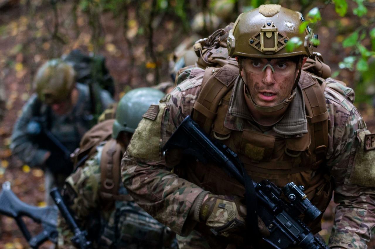 Armed airmen on patrol.
