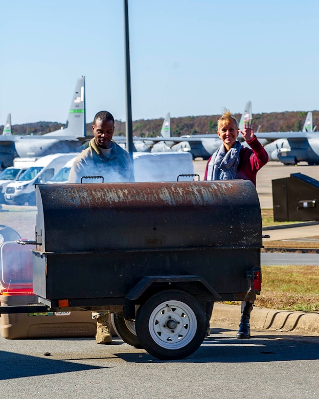 Tech. Sgt. Caleb Black (left), 913th Maintenance Squadron, and Chief Master Sgt. Kimberly Lord (right), 913th Airlift Group Superintendent, cook hamburgers and hot dogs on Nov. 2, 2019, at Little Rock Air Force Base, Ark. The 913th Airlift Group hosted the event, celebrating and showing appreciation for family members' support of their Airmen. (U.S. Air Force Reserve photo by Maj. Ashley Walker)