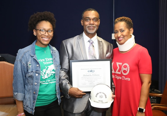 Code 105.7 Michael Williams and family celebrate his completion of the Executive Development Program.