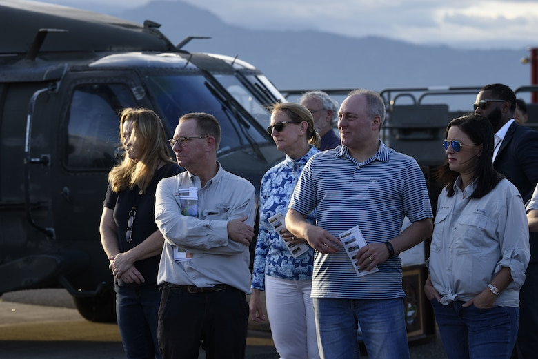 Members of the US House of Representatives stand in front of a UH-60 Blackhawk on Soto Cano Air Base.