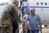 Mr. Steven Scalise, Minority Whip US House of Representatives, is greeted by US Army Col. Steven Barry as he deboards his plane