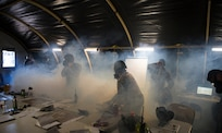 Airmen evacuate the Emergency Operations Center after a simulated chemical attack during Palmetto Challenge at McEntire Joint National Guard Base, S.C., Nov. 3, 2019. The goal of the exercise was to develop and maintain full-spectrum readiness and ensure JB Charleston's Airmen were ready for rapid mobilization and able to support Air Mobility Command and DOD priorities. Both active-duty and reserve Airmen from the 628th Air Base Wing, 437th Airlift Wing and 315th Airlift Wing came together to train in operating in an austere environment. More than 140 Airmen took part in the global mobilization readiness exercise at McEntire Joint National Guard Base, and Pope Army Airfield, S.C.
