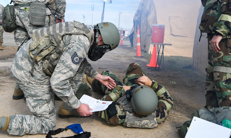 Tech. Sgt. Richard Moss, 628th Fighter Wing Judge Advocate legal specialist performs simulated first-aid care in response to a chemical attack exercise during Palmetto Challenge at McEntire Joint National Guard Base, S.C., Nov. 3, 2019. The goal of the exercise was to develop and maintain full-spectrum readiness and ensure JB Charleston's Airmen were ready for rapid mobilization and able to support Air Mobility Command and DOD priorities. Both active-duty and reserve Airmen from the 628th Air Base Wing, 437th Airlift Wing and 315th Airlift Wing came together to train in operating in an austere environment. More than 140 Airmen took part in the global mobilization readiness exercise at McEntire Joint National Guard Base, and Pope Army Airfield, S.C.