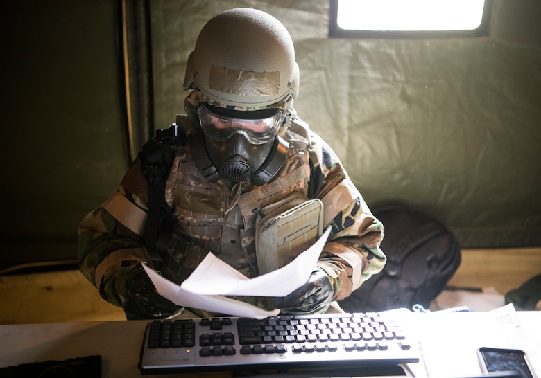 U.S. Air Force Staff Sgt. Jordan Stinson, 628th Comptroller Squadron financial analyst, looks over simulated financial purchases after a chemical attack exercise during Palmetto Challenge at McEntire Joint National Guard Base, S.C., Nov. 3, 2019. The goal of the exercise was to develop and maintain full-spectrum readiness and ensure JB Charleston's Airmen were ready for rapid mobilization and able to support Air Mobility Command and DOD priorities. Both active-duty and reserve Airmen from the 628th Air Base Wing, 437th Airlift Wing and 315th Airlift Wing came together to train in operating in an austere environment. More than 140 Airmen took part in the global mobilization readiness exercise at McEntire Joint National Guard Base, and Pope Army Airfield, S.C.