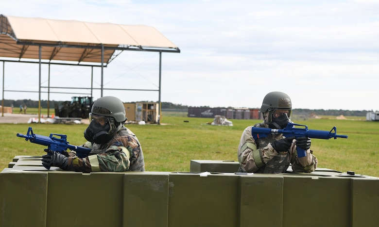 Airmen guard their post at a defensive position during Palmetto Challenge at McEntire Joint National Guard Base, S.C., Nov. 3, 2019. The goal of the exercise was to develop and maintain full-spectrum readiness and ensure JB Charleston's Airmen were ready for rapid mobilization and able to support Air Mobility Command and DOD priorities. Both active-duty and reserve Airmen from the 628th Air Base Wing, 437th Airlift Wing and 315th Airlift Wing came together to train in operating in an austere environment. More than 140 Airmen took part in the global mobilization readiness exercise at McEntire Joint National Guard Base, and Pope Army Airfield, S.C.