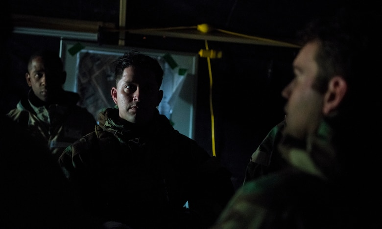 Emergency Operations Center Airmen meet in their backup location after a power outage at Palmetto Challenge at McEntire Joint National Guard Base, S.C., Nov. 3, 2019. The goal of the exercise was to develop and maintain full-spectrum readiness and ensure JB Charleston's Airmen were ready for rapid mobilization and able to support Air Mobility Command and DOD priorities. Both active-duty and reserve Airmen from the 628th Air Base Wing, 437th Airlift Wing and 315th Airlift Wing came together to train in operating in an austere environment. More than 140 Airmen took part in the global mobilization readiness exercise at McEntire Joint National Guard Base, and Pope Army Airfield, S.C.
