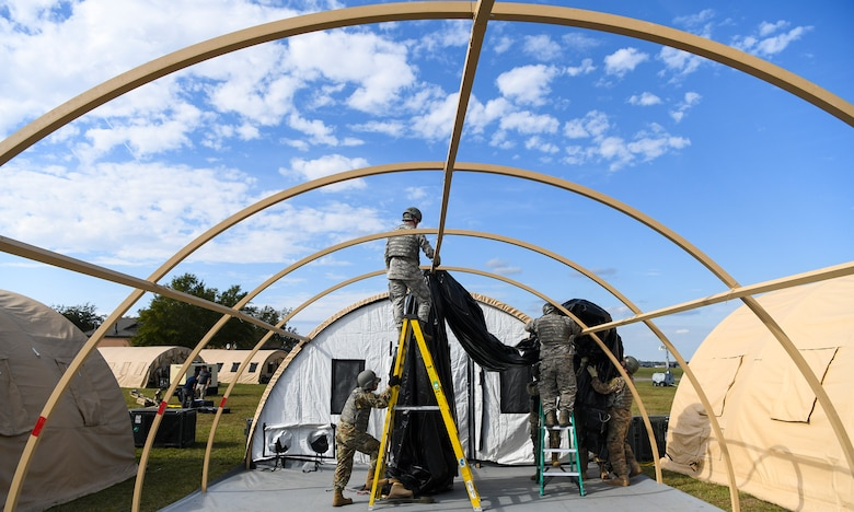 Airmen assigned to the 628th Civil Engineer Squadron break down tents that were used for Palmetto Challenge in preparation for the redeployment order at McEntire Joint National Guard Base, S.C., Nov. 4, 2019. The goal of the exercise was to develop and maintain full-spectrum readiness and ensure JB Charleston's Airmen were ready for rapid mobilization and able to support Air Mobility Command and DOD priorities. Both active-duty and reserve Airmen from the 628th Air Base Wing, 437th Airlift Wing and 315th Airlift Wing came together to train in operating in an austere environment. More than 140 Airmen took part in the global mobilization readiness exercise at McEntire Joint National Guard Base, and Pope Army Airfield, S.C. (U.S. Air Force photo by Senior Airman Cody R. Miller)
