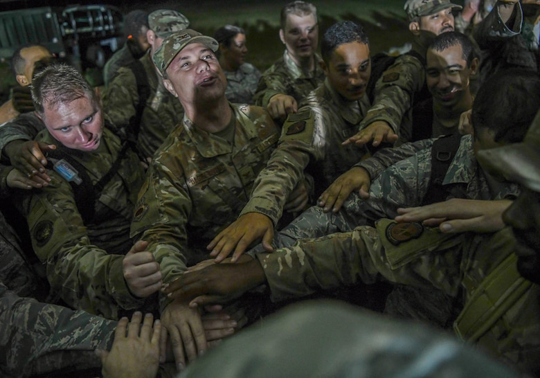 U.S. Air Force Col. Bobby DeGregorio, 315th Airlift Wing Mission Support Group and Palmetto Challenge exercise commander joins in a celebratory moment with his Airmen after the redeployment orders are announced at McEntire Joint National Guard Base, S.C., Nov. 4, 2019. The goal of the exercise was to develop and maintain full-spectrum readiness and ensure JB Charleston's Airmen were ready for rapid mobilization and able to support Air Mobility Command and DOD priorities. Both active-duty and reserve Airmen from the 628th Air Base Wing, 437th Airlift Wing and 315th Airlift Wing came together to train in operating in an austere environment. More than 140 Airmen took part in the global mobilization readiness exercise at McEntire Joint National Guard Base, and Pope Army Airfield, S.C.