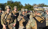 Defenders assigned to the 628th Security Forces Squadron receive their morning briefing during exercise Palmetto Challenge at McEntire Joint National Guard Base, S.C., Nov. 3, 2019. The goal of the exercise was to develop and maintain full-spectrum readiness and ensure JB Charleston's Airmen were ready for rapid mobilization and able to support Air Mobility Command and DOD priorities. Both active-duty and reserve Airmen from the 628th Air Base Wing, 437th Airlift Wing and 315th Airlift Wing came together to train in operating in an austere environment. More than 140 Airmen took part in the global mobilization readiness exercise at McEntire Joint National Guard Base, and Pope Army Airfield, S.C.