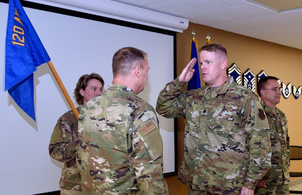 Lt. Col. Jonathan Bingham salutes Col. Buel Dickson, 120th Airlift Wing Commander, upon assuming command of the 120th Medical Group during a change of command ceremony Nov. 3, 2019 here.
