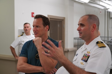 U.S. PACFLT Director of Intelligence and Information Operations Capt. Tony Butera, considered the current equivalent of World War II intelligence officer Edwin Layton, walks actor Patrick Wilson through Station Hypo during a special tour of the now-declassified space.