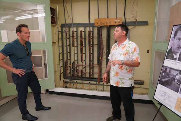 PHNSY&IMF Engineering Technician Noah Green gives actor Patrick Wilson an overview of the fiddle board once used to intercept encrypted Japanese intelligence at Station Hypo.