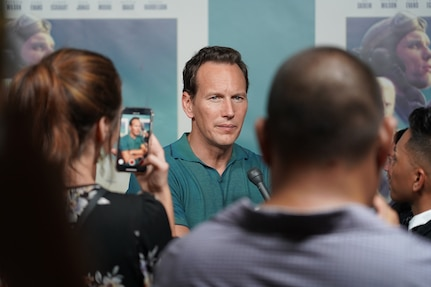 Hollywood actor Patrick Wilson answers media questions at the Midway red carpet premiere at Sharkey Theater on Joint Base Pearl Harbor-Hickam. Wilson toured Station Hypo located at PHNSY&IMF's Building 1 ahead of the premiere. Wilson plays Edwin Layton, an intelligence officer who worked at Pearl Harbor –including at Station Hypo– during World War II, in the film.