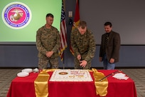 As the oldest, youngest and senior-ranked members, Joint Task Force Civil Support Chief of Staff U.S. Marine Corps Col. Timothy Powledge (middle), U.S. Marine Corps SSgt. Jordan Freking (left) and U.S. Marine Corps Maj. (ret) Stan Bacon (right) cut the cake during the 244th Marine Corps birthday celebration. The cake-cutting ceremony signifies an annual renewal of each Marine's commitment to the Marine Corps, and the Marine Corps' commitment to our nation. The tradition of the youngest and oldest Marine cutting the cake signifies the passing of knowledge and experience from senior to junior. (Official DoD photo by Mass Communication Specialist 3rd Class Michael Redd/RELEASED)