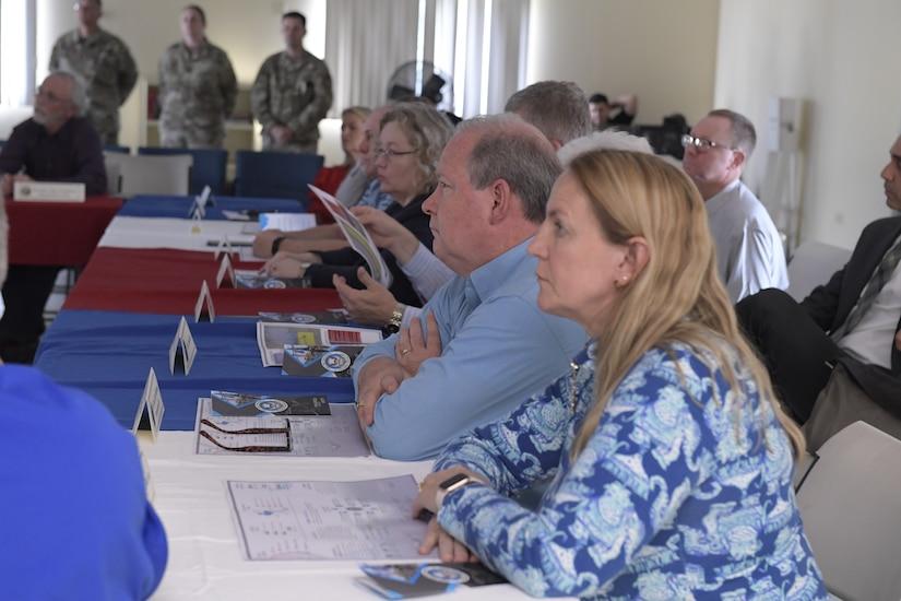 Congressional delegates listen to a brief