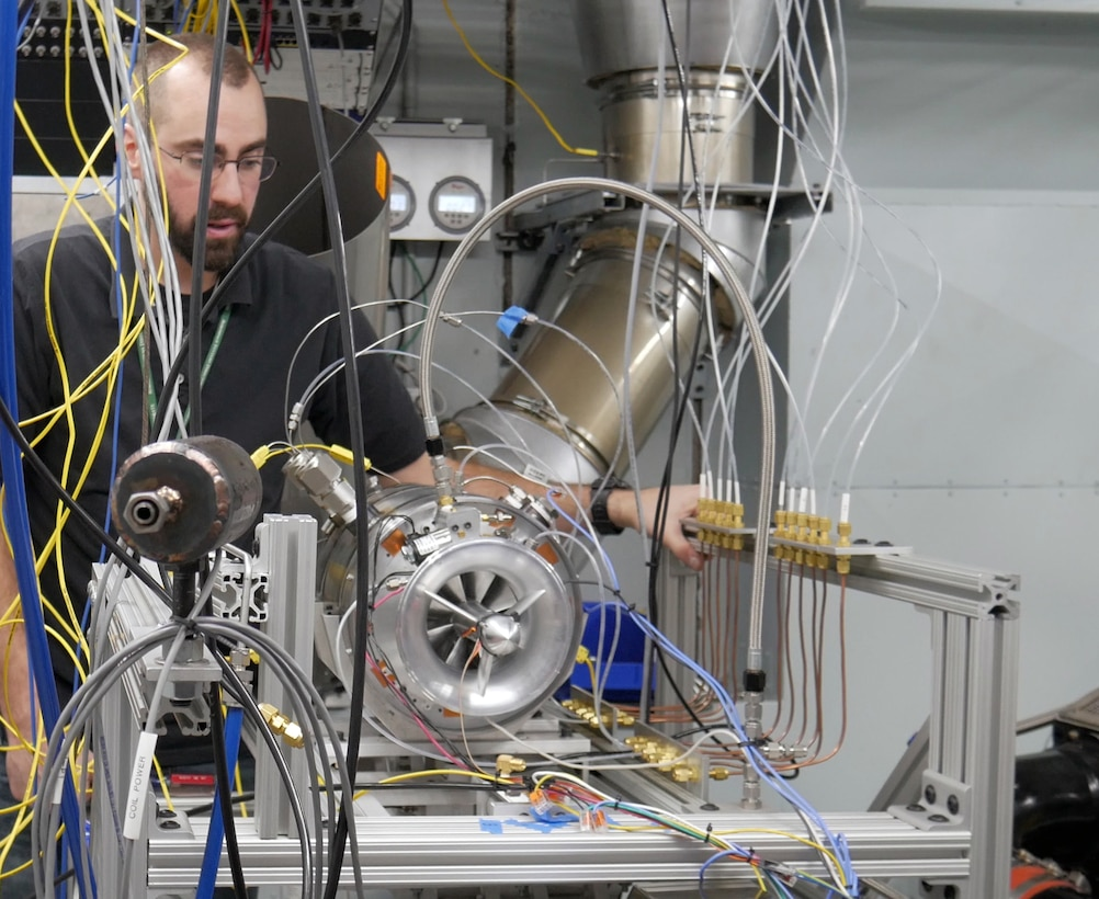 Air Force Research Laboratory engineer Justin Reinhart makes final adjustments on the Responsive Open Source Engine on the test stand. ROSE is a rapid development effort executed within 13 months and is the first turbine engine designed, assembled, and tested exclusively within AFRL. (U.S. Air Force Photo/David Dixon)