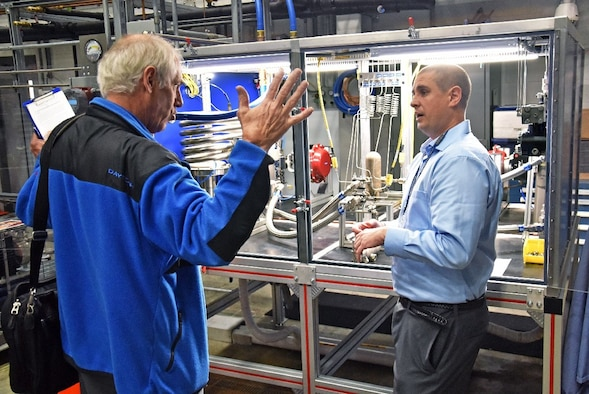 Marvin Gale, MAMLS Program Manager (left) and Grady Marcum, AFRL chemical engineer, discuss the new heat exchange tester during the capability's kick-off tour, held Nov. 6. (U.S. Air Force Photo/Spencer Deer)