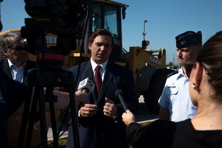 Ron DeSantis, Governor of Florida, left, and Brian Laidlaw, 325th Fighter Wing commander, right, are interviewed at a press pool during a groundbreaking ceremony Nov. 6, 2019, at Tyndall Air Force Base, Florida. A groundbreaking ceremony for the U.S. 98/Tyndall Air Force Base Flyover was held at Tyndall's Flag Park. The flyover will improve mobility by separating through traffic on U.S. 98 from drivers entering and exiting Tyndall. The project represents a continued partnership with the State of Florida in supporting the rebuild process of Tyndall. This was a collaborative effort of the Florida Department of Transportation, the Federal Highway Administration, and Tyndall's 325th Fighter Wing. (U.S. Air Force photo by Staff Sgt. Magen M. Reeves)