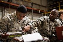 Airmen fill out paperwork