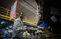 Airman performs security check