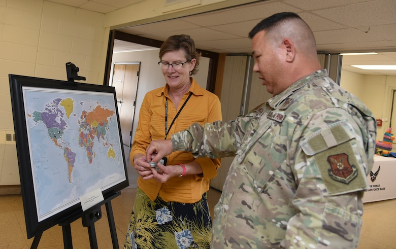 U.S. Air Force Chaplain (Maj.) Craig H. Nakagawa, 377th Deputy Wing chaplain, and Teresa L. Reinhard, 377th Air Base Wing community support coordinator, point out their location on a map at the Diversity Heritage Day event on Kirtland Air Force Base, N.M., Nov. 6, 2019.  Attendees placed a pin on their region of origin to highlight their diversity. (U.S. Air Force photo by Airman 1st Class Ireland Summers)