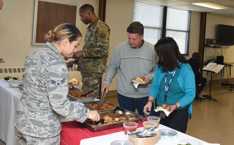 Attendees sample various foods at the first Diversity Heritage Day on Kirtland Air Force Base, N.M., Nov. 6, 2019. The event was created to educate the workforce on ethnic barriers in the workplace. (U.S. Air Force photo by Airman 1st Class Ireland Summers)